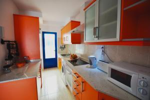 A kitchen or kitchenette at Casa Paradiso with great views perfect for surf or family holidays
