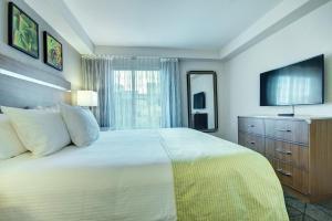 Ein Bett oder Betten in einem Zimmer der Unterkunft Desert Rose Resort