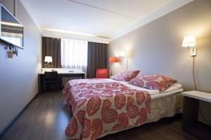 Кровать или кровати в номере Scandic Kajanus