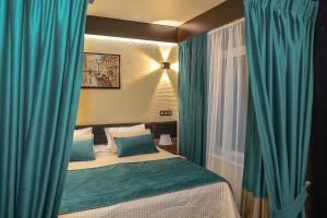 Кровать или кровати в номере Босиком Истра Курорт и Коттеджи