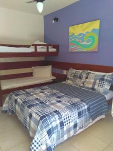 Cama ou camas em um quarto em Pousada Praia D'Azul