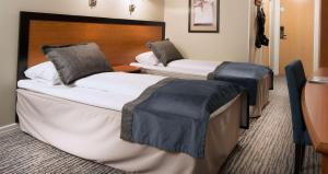 En eller flere senger på et rom på Scandic Lillehammer Hotel
