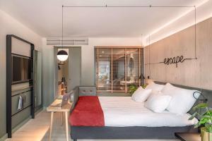 سرير أو أسرّة في غرفة في فندق نورغ باي سكانديك