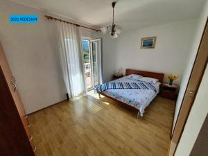 A bed or beds in a room at Apartment LANKA
