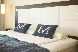 En eller flere senger på et rom på Scandic Maritim