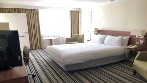 A bed or beds in a room at Holiday Inn Ipswich, an IHG Hotel
