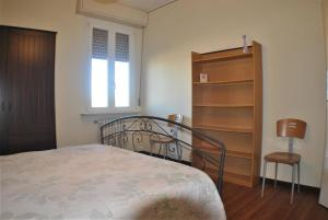 A bed or beds in a room at Lombardi Fleming