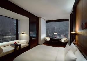 A bed or beds in a room at The Puli Hotel And Spa