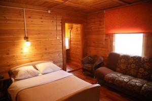 Кровать или кровати в номере Боярский Двор Андреевский