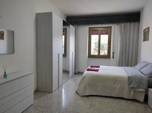 A bed or beds in a room at Casa Di Roma