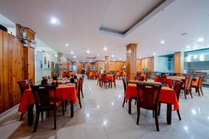 A restaurant or other place to eat at Olympus Plaza Hotel