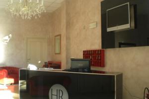 Телевизор и/или развлекательный центр в Hotel Romagna