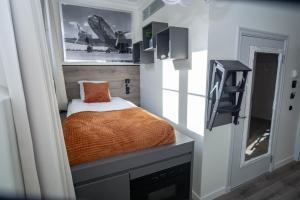 A bed or beds in a room at Déus Longstay