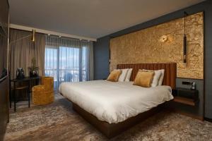 Un ou plusieurs lits dans un hébergement de l'établissement Alexander Hotel