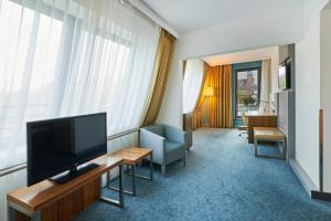 A television and/or entertainment center at Radisson Blu Hotel Krakow