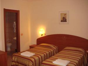 A bed or beds in a room at Complesso L'Oasi
