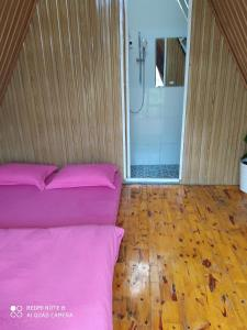 A bed or beds in a room at Tuyết Hoa Hòn Bồ Bungalow