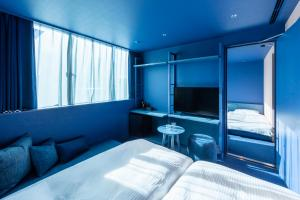 A bed or beds in a room at toggle hotel suidobashi TOKYO