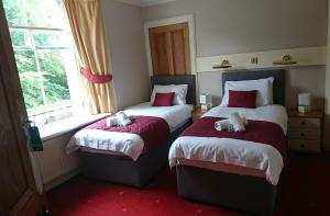 A bed or beds in a room at Woodlands Bed and Breakfast
