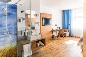 TV/Unterhaltungsangebot in der Unterkunft Das Aunhamer Suite & Spa Hotel