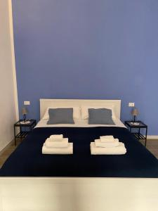 Letto o letti in una camera di Nenetta Rooms & Suites