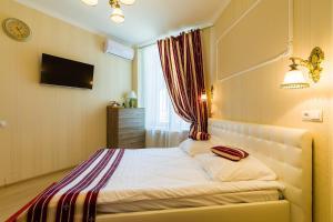 Кровать или кровати в номере Royal Capital