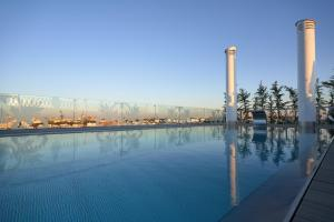 The swimming pool at or near Monte Triana