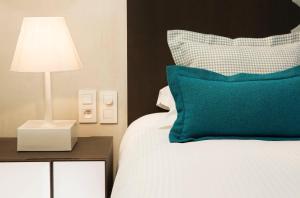 Un ou plusieurs lits dans un hébergement de l'établissement Hotel D - Strasbourg
