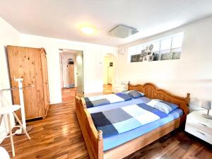 Ein Bett oder Betten in einem Zimmer der Unterkunft Pilatus Apartments
