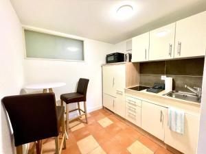 Küche/Küchenzeile in der Unterkunft Pilatus Apartments