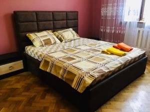 A bed or beds in a room at Victory Park Apartments