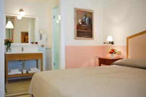 Ein Bett oder Betten in einem Zimmer der Unterkunft Piazza Di Spagna Prestige