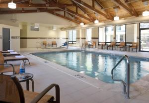 The swimming pool at or near Courtyard by Marriott Anchorage Airport