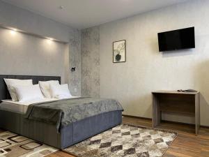 Кровать или кровати в номере Гостиница Солнечный Ветер