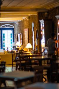 Um restaurante ou outro lugar para comer em Pousada Porto Imperial