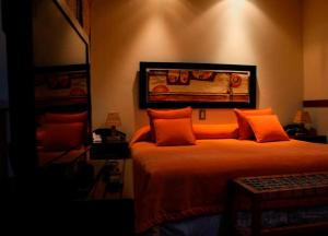 A bed or beds in a room at Hotel Los Sauces