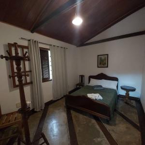 A bed or beds in a room at Pousada Solar dos Vieiras