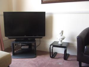 A television and/or entertainment center at Alister Guest House
