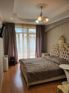 Кровать или кровати в номере Гостевой дом Орхидея