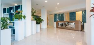 The lobby or reception area at Best Western Plus Tigullio Royal