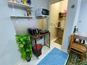 مطبخ أو مطبخ صغير في Caesar Studio Apartment