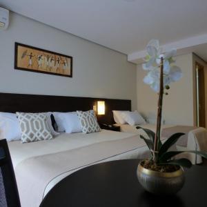 Cama ou camas em um quarto em Hotel Querência