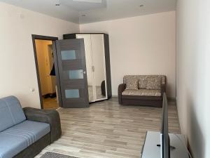 Гостиная зона в Апартаменты на Окружной