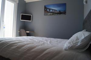 Un ou plusieurs lits dans un hébergement de l'établissement Hôtel L'Embarcadère