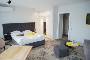A bed or beds in a room at Hotel Krosno-Nafta