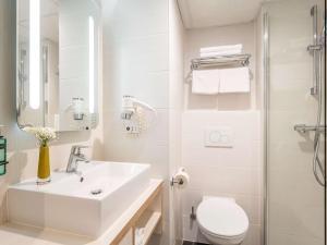Ein Badezimmer in der Unterkunft Mercure Oostende