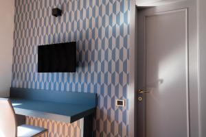 Телевизор и/или развлекательный центр в Hotel Enzo