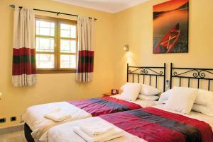 Cama o camas de una habitación en Las Sierras 132