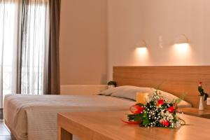 A bed or beds in a room at Silver Beach Hotel & Apartments