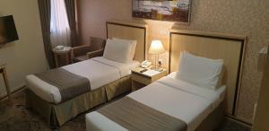 Cama ou camas em um quarto em Al Massa Hotel Makkah